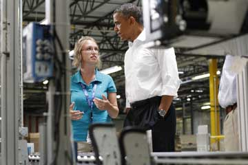 President Barack Obama speaks to Amazon employee Adrienne Thompson during a tour of the Pack Mezzanine at the Amazon Fulfillment Center in Chattanooga, TN